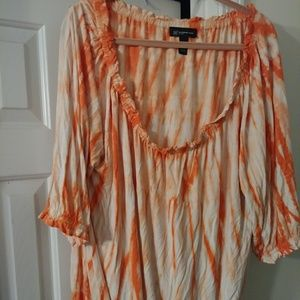 Orange and white tie dye shirt